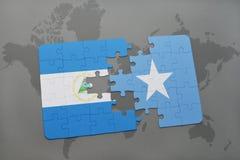 raadsel met de nationale vlag van Nicaragua en Somalië op een wereldkaart Royalty-vrije Stock Afbeelding