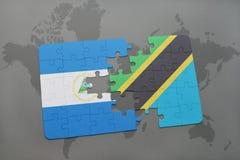 raadsel met de nationale vlag van Nicaragua en Tanzania op een wereldkaart Stock Fotografie