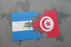 raadsel met de nationale vlag van Nicaragua en Tunesië op een wereldkaart Royalty-vrije Stock Afbeeldingen