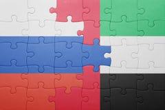 Raadsel met de nationale vlag van verenigd Arabisch emiraten en Rusland stock afbeeldingen
