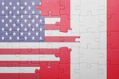 Raadsel met de nationale vlag van de Verenigde Staten van Amerika en Peru stock foto