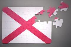 Raadsel met de vlag van de staat van Alabama stock foto