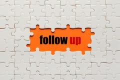 raadsels Bedrijfsillustratie met de inschrijving: follow-up Royalty-vrije Stock Foto's