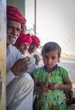 Rabari tribesmen and girl. GODWAR REGION, INDIA - 12 FEBRUARY 2015: Rabari tribesman with other members while granddaughter stands next to him. Rabari or Rewari royalty free stock image
