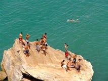 Rabat Swimming Boys. Moroccan boys swimming off a rock in Bou Reg Reg - Rabat, Morocco Stock Photos