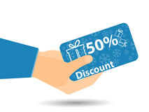 Rabattkuponger i hand rabatt 50-percent Specialt erbjudande Snöflingor och gåvaaskar Arkivbild