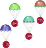 Rabaty latają puszek na spadochronach Obrazy Royalty Free