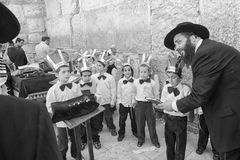A Rabbi Teacher with his students at the Westren wall, Jerusalem Royalty Free Stock Image