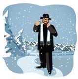 Rabbin som rymmer en dreidel i snöig plats Arkivfoton