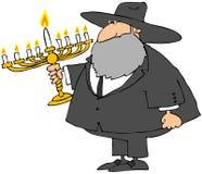 Rabbiner, der ein Menorah anhält Stockfotografie