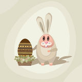 Rabbit-02. Illustration for Easter. Easter Bunny with the Easter egg in a pot with flowers Royalty Free Stock Photography