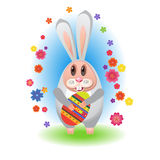 Rabbit-04. Easter song. Rabbit with eggs for Easter with flowers Stock Photo