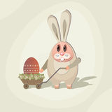 Rabbit-06. Easter Illustration. Rabbit with the Easter egg in the cart with flowers Royalty Free Stock Photography