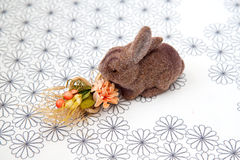 Rabbit. Toy rabbit with a flowers Royalty Free Stock Photography