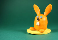 Rabbit. Orange rabbit on green. Made from plasticine Stock Photography