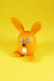 Rabbit. Orange rabbit on yellow. Made from plasticine Royalty Free Stock Photos