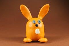 Rabbit. Plasticine rabbit on brown background Royalty Free Stock Photography