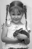 Rabbit. The girl is played with the rabbit Royalty Free Stock Image