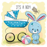Rabbit with baby carriage Royalty Free Stock Images