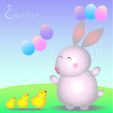 Rabbit baby and little chickens on the lawn. Little Easter rabbit with balloons and chickens in the meadow Stock Photo