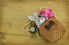 Rabbit in bag with flowers Royalty Free Stock Photo