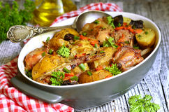 Rabbit baked with young potato in a cream. Stock Image