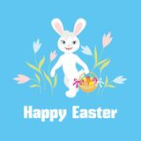 Rabbit and a basket with Easter eggs Royalty Free Stock Images