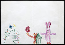 Rabbit and Bear next to the Christmas Tree. Child's Drawing. Royalty Free Stock Photo