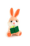 Rabbit with book. Sitting rabbit toy with book over white background Royalty Free Stock Photo