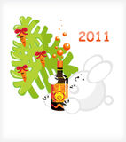 Rabbit bottle. White rabbit with a bottle of drink under the tree with a carrot Stock Image