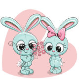 Rabbit boy and girl. On a heart background Royalty Free Stock Photos