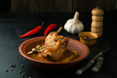 Rabbit braised in sauce with polenta and spices Stock Photos