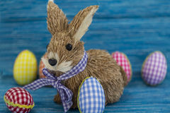 Rabbit, bunny, Coloring eggs, painted, blue background, green, yellow, red, orange, colored, Royalty Free Stock Photos