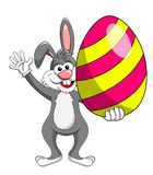 Rabbit or bunny holding colorful big egg isolated. On white Stock Photos