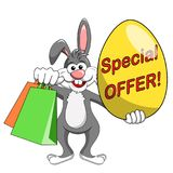 Rabbit or bunny holding special offer big egg and shopping bags. For easter sale isolated on white Stock Photo