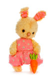Rabbit bunny toy with carrot isolated in hand Royalty Free Stock Photography