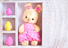 Rabbit bunny toy and easter eggs on the case Royalty Free Stock Image