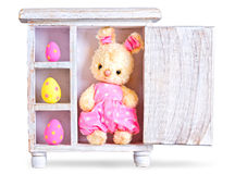 Rabbit bunny toy and easter eggs ona wood case isolated Stock Photos