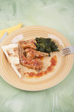Rabbit cacciatore with spinach Stock Image