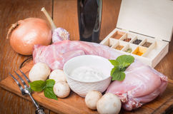 Rabbit carcass,  garlic, onion, sour cream, mushrooms and spices Royalty Free Stock Images