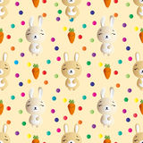 Rabbit and carrot on a beige background Stock Photography
