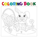 Rabbit carrying a decorated Easter egg. Coloring book Stock Photo