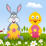 Rabbit & Chick with Easter Eggs in Meadow Stock Photo