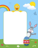 Rabbit & Chick Photo Frame. Photo frame, post card or page for your scrapbook. Subject: a funny chick and a cute bunny with Easter egg in a park with flowers Royalty Free Stock Images