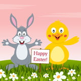 Rabbit and Chick Wishing a Happy Easter Royalty Free Stock Images
