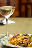 Rabbit and chicken paella with vegetables. Traditional Spanish f Stock Photography