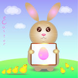 Rabbit and chickens in the meadow. Rabbit shows little chickens picture Easter egg Stock Photos