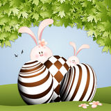 Rabbit with chocolate eggs for Easter Royalty Free Stock Photography