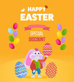 Rabbit in clothes, holding an Easter egg in his hand. A cute rabbit in beautiful festive clothes, holding an Easter egg in his hand. Easter greeting card with Stock Photo