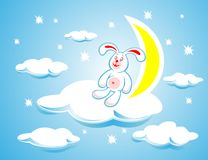Rabbit on a cloud. The white rabbit sitting on a cloud on a background of the moon and stars Stock Photo